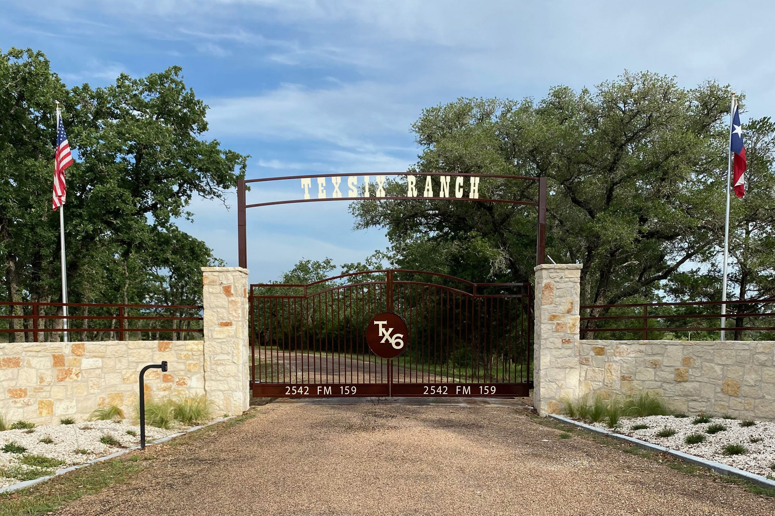 texas themed ranch gate with stone - tall