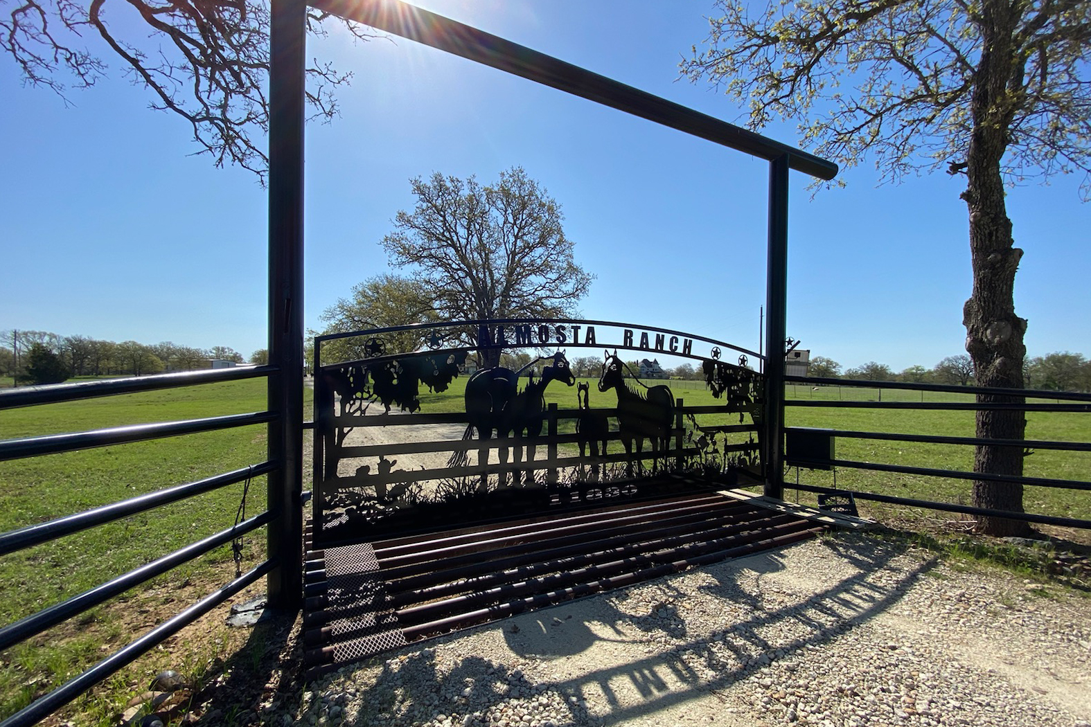horse ranch gate with overhang bar - iron fencing