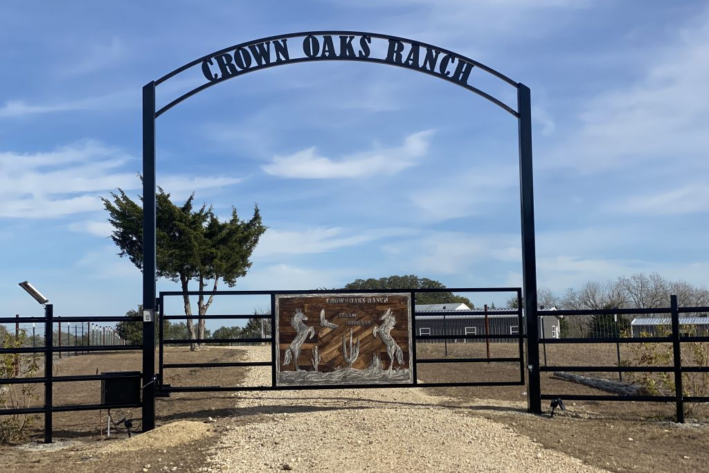 wood artwork panel for fence gate with overhang ranch name