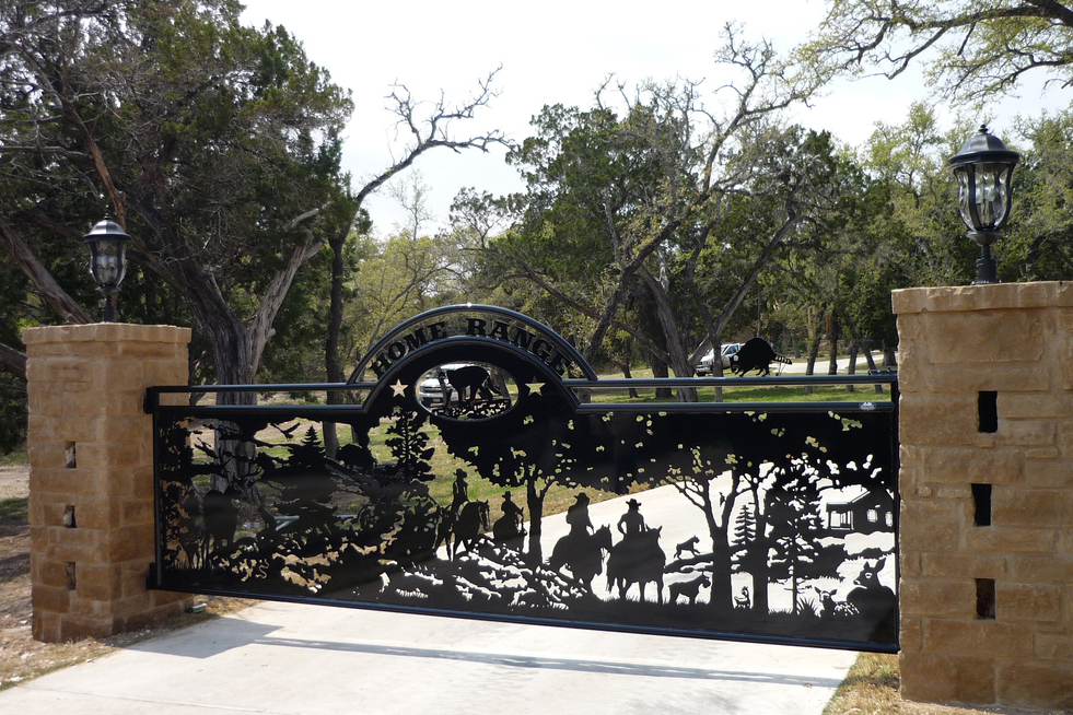 cowboy ranch gate with stone columns